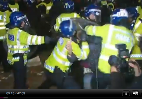 officer smothering protester